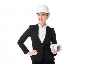 Female construction engineer in suit holding blueprint isolated on white