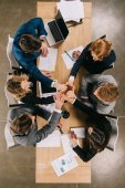 overhead view of business partners at table in office, businesspeople teamwork collaboration relation concept