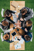 Fotografie Top view of business partners at table in office, businesspeople teamwork collaboration relation concept