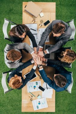 Top view of business partners at table in office, businesspeople teamwork collaboration relation concept