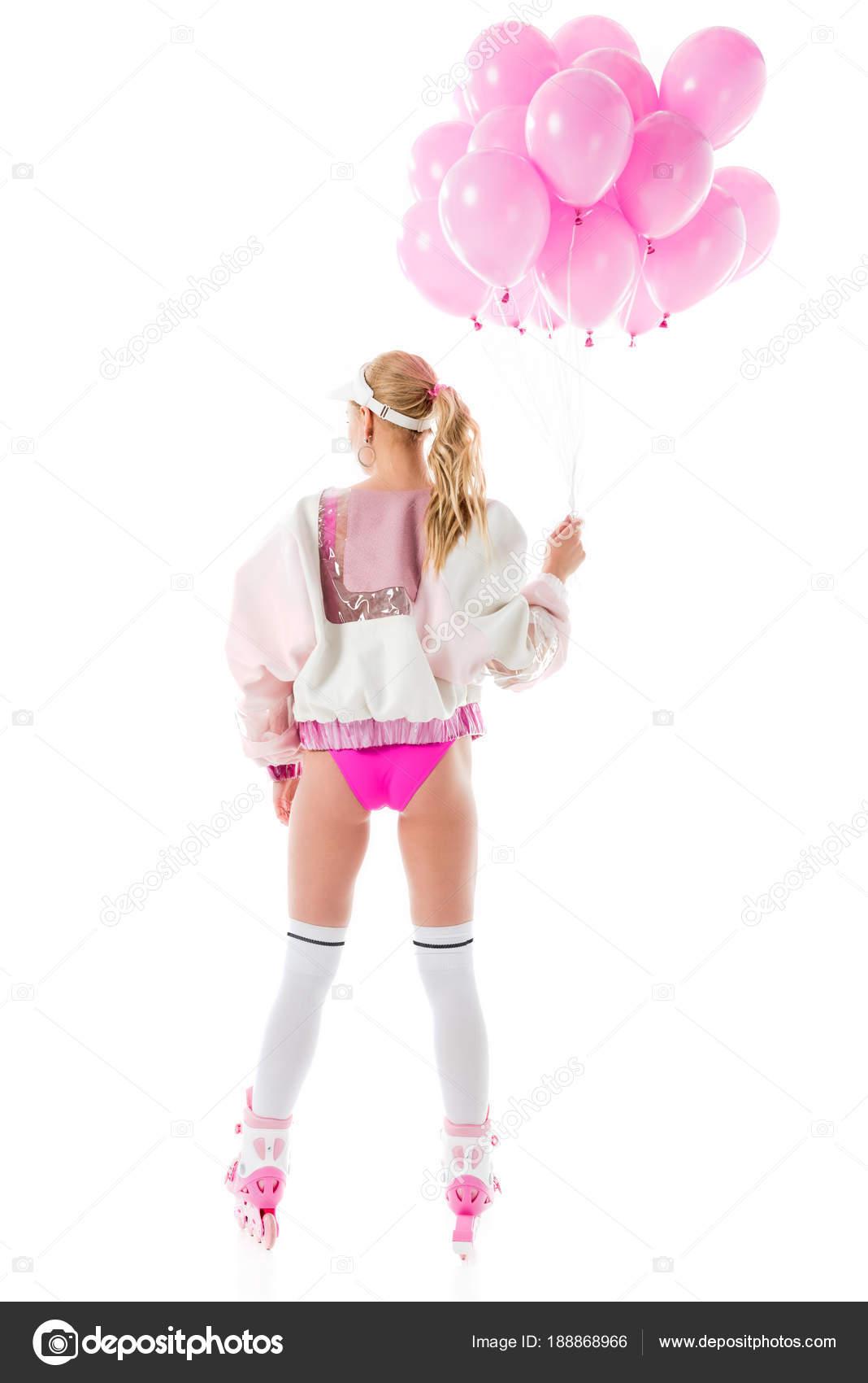 e36a83a07 Atractivo joven en patines rosa con globos aislados en blanco– imagen de  stock