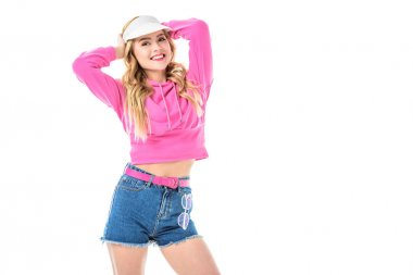 Blonde woman in pink clothes and tennis cap isolated on white
