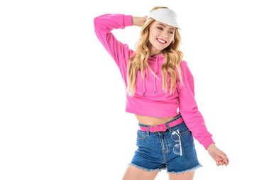 Blonde woman in pink clothes posing isolated on white