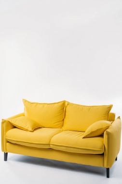 studio shot of trendy yellow sofa, on white