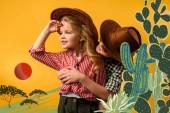kis cowboy átfogó elegáns cowgirl, elszigetelt, a sárga kaktuszok illusztráció