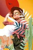 Photo beautiful stylish traveler on safari, isolated on yellow with cactuses and elephant illustration
