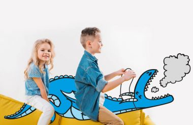happy siblings riding drawn blue dragon while sitting on sofa