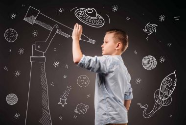 preteen boy pretending to be a astronomer with drawn telescope and UFO, planets, spaceship and stars icons