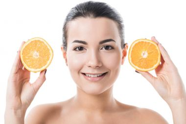 Smiling attractive naked girl with clean skin holding orange halves isolated on white stock vector