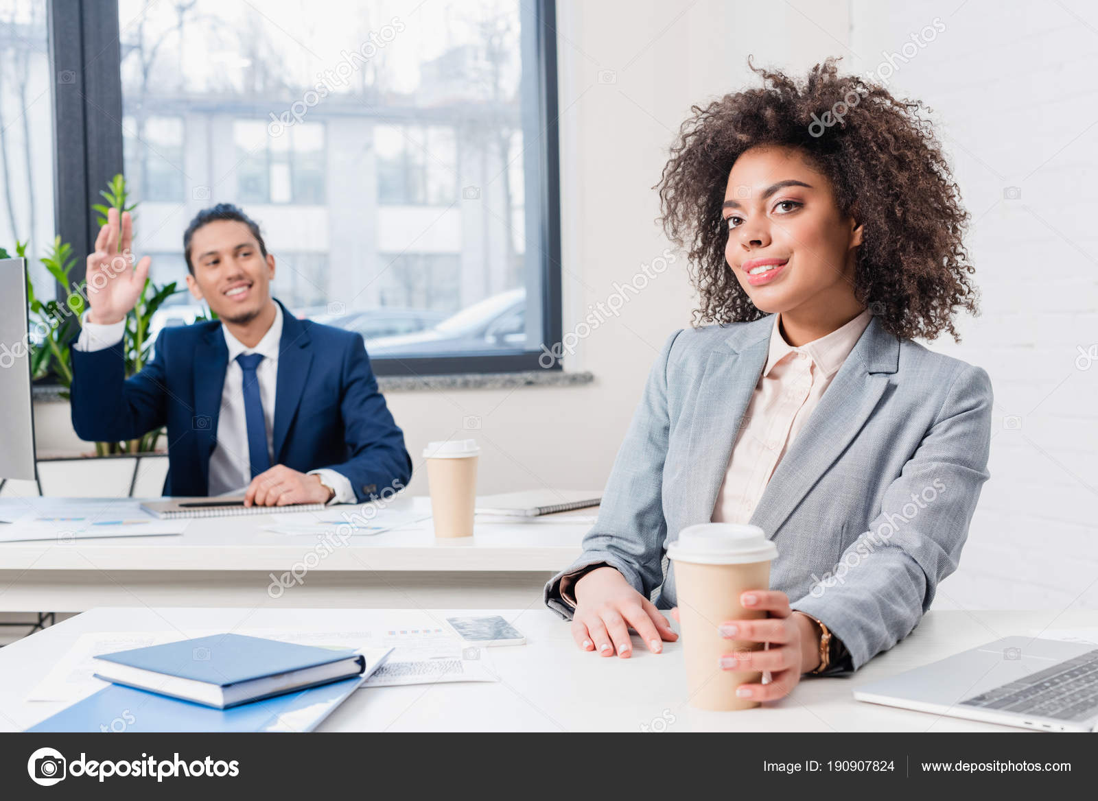 Businessman greeting someone businesswoman holding coffee cup office businessman greeting someone businesswoman holding coffee cup office stock photo m4hsunfo