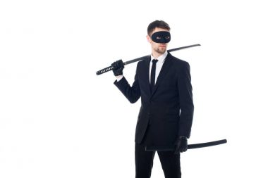 spy agent in mask and gloves with katana looking away isolated on white