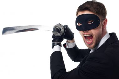 portrait of emotional spy agent in mask and gloves with katana isolated on white