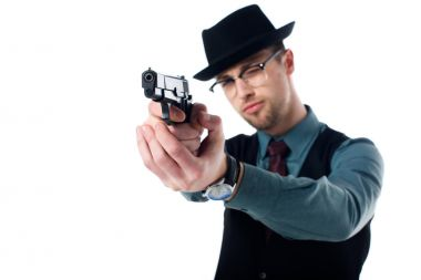 Portrait of spy agent in hat and eyeglasses with gun isolated on white stock vector