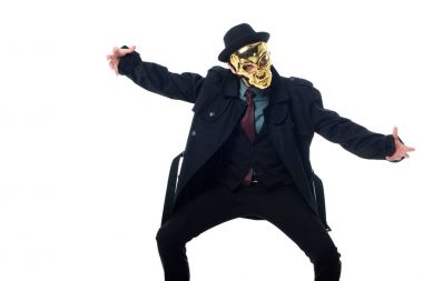 criminal in mask, hat and black coat posing isolated on white