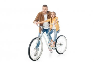 smiling father and little daughter on bicycle isolated on white