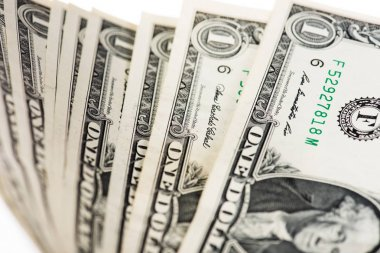 close-up view of one dollar banknotes on white, selective focus