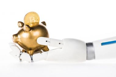 close-up view of robotic arm holding golden piggy bank with bitcoin isolated on white