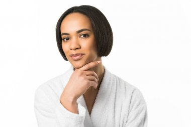 smiling african american woman posing in bathrobe,  isolated on white