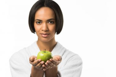 attractive african american woman holding apple,  isolated on white