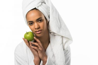 beautiful african american woman in towel posing with apple,  isolated on white