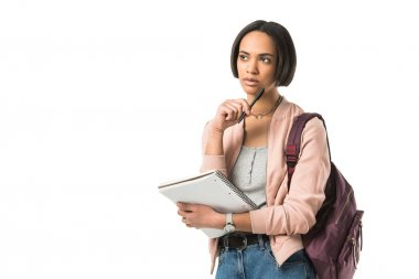 pensive female african american student with backpack and copybook,  isolated on white