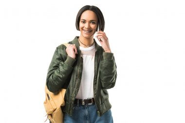 beautiful smiling african american student with backpack talking on smartphone, isolated on white
