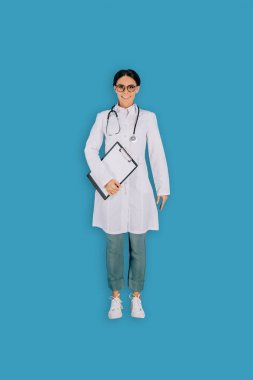 Top view of female doctor with stethoscope and clipboard isolated on blue background stock vector