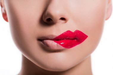 cropped image of woman with red lips print on cheek isolated on white