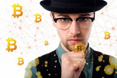 Portrait of man in eyeglasses and hat holding golden bitcoin on white stock vector