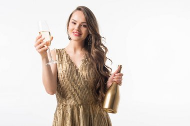 beautiful woman standing with bottle and glass of champagne isolated on white