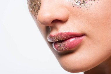 cropped image of woman with glitter on face isolated on white