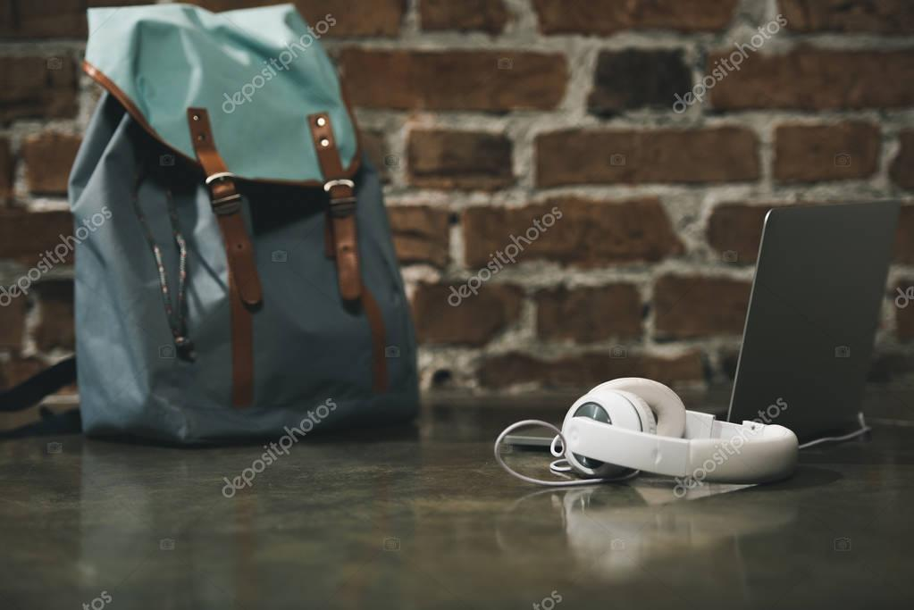 Hipster backpack, headphones and laptop
