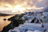 white houses on greek island near sea in evening