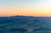 západ slunce a klidné Egejské moře v řece