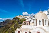sunlight on church near white houses in greek island
