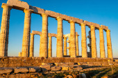 Photo sunshine on ancient columns of parthenon in athens