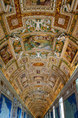 paintings on walls and ceiling in gallery of maps at vatican museum