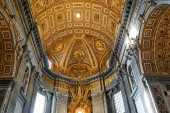VATICAN CITY, ITALY - APRIL 10, 2020: interior of ancient st peters basilica with paintings of Michelangelo