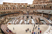 ROME, ITALY - APRIL 10, 2020: people walking in historical colosseum