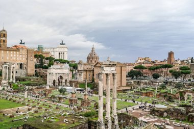 historical roman forum against sky with clouds in italy