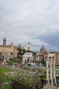 historical landmarks of rome against sky with clouds