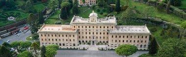 Horizontal crop of ancient building near gardens of Vatican stock vector