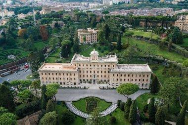 Ancient building near green gardens of Vatican stock vector