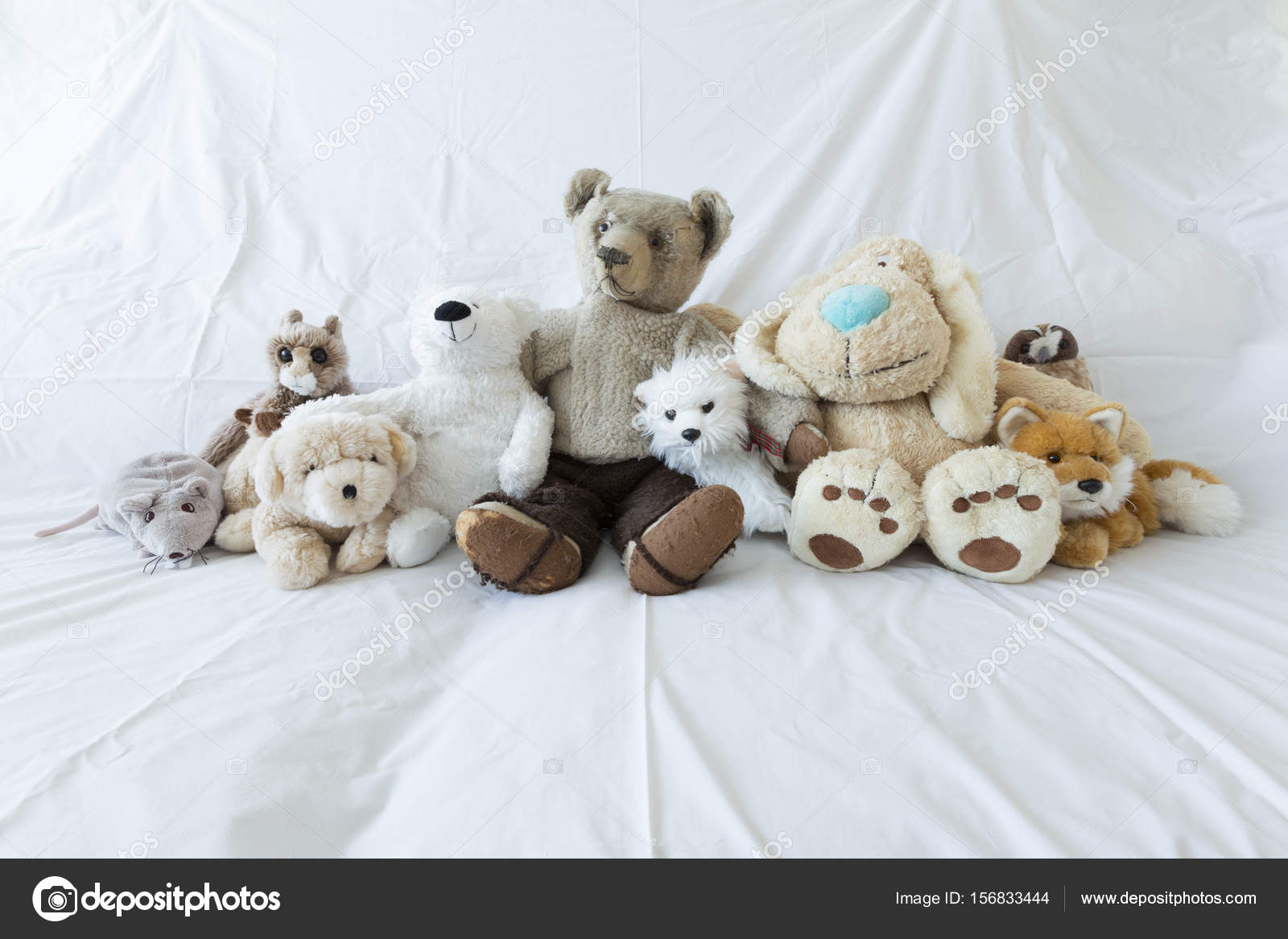 Group Of Cute Stuffed Animals On A White Couch Stock Photo