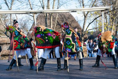 Bucharest, Romania, 25th of December 2019: Christmas tradition festival in Balkans, Romanian dancers and actors in traditional and gypsy clothes