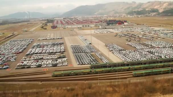 aerial view of big parking lot of new cars from car factory in slovakia