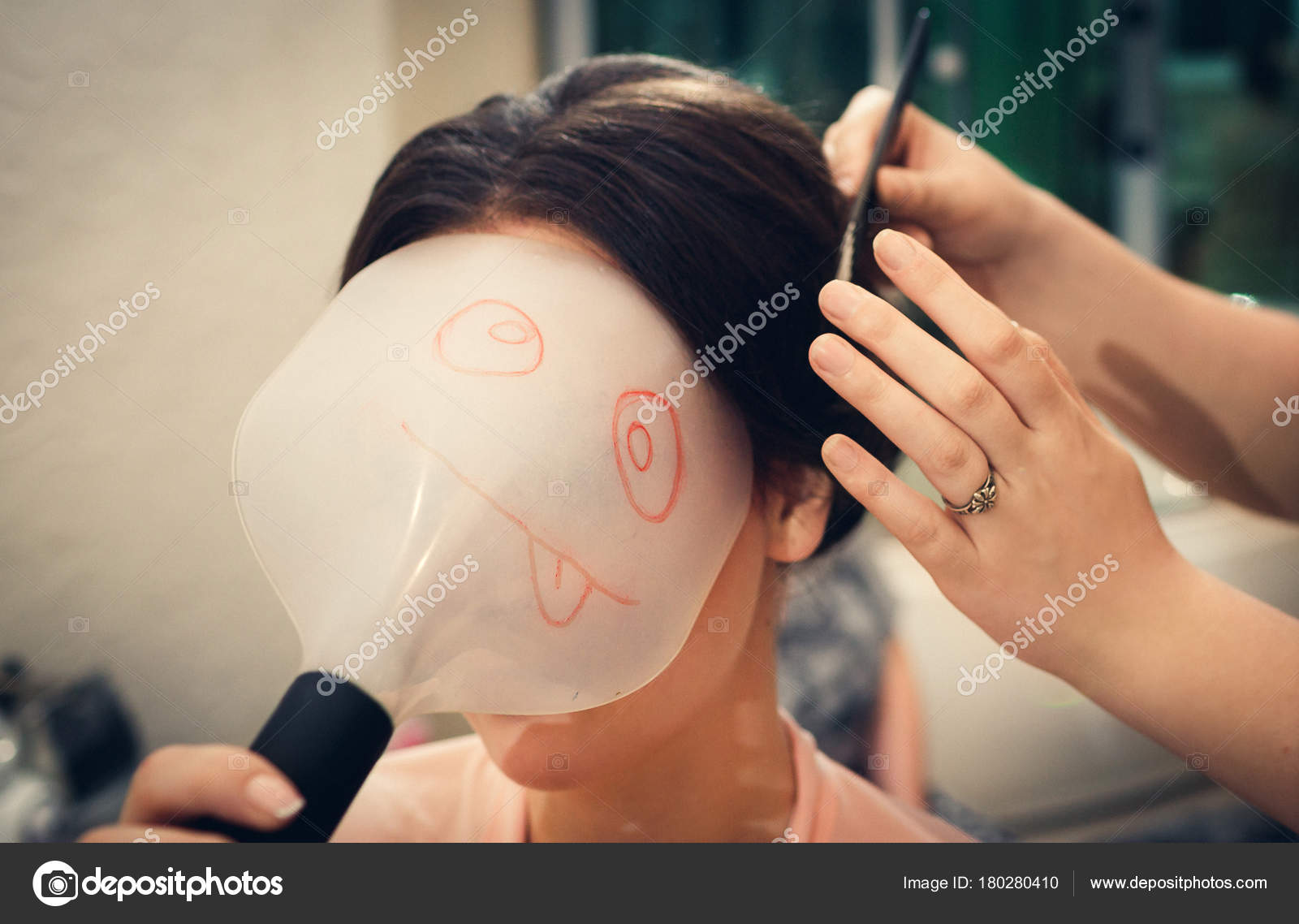 Girl with a funny face shield. The hairdresser does hair styling — Stock  Photo f6666ecde