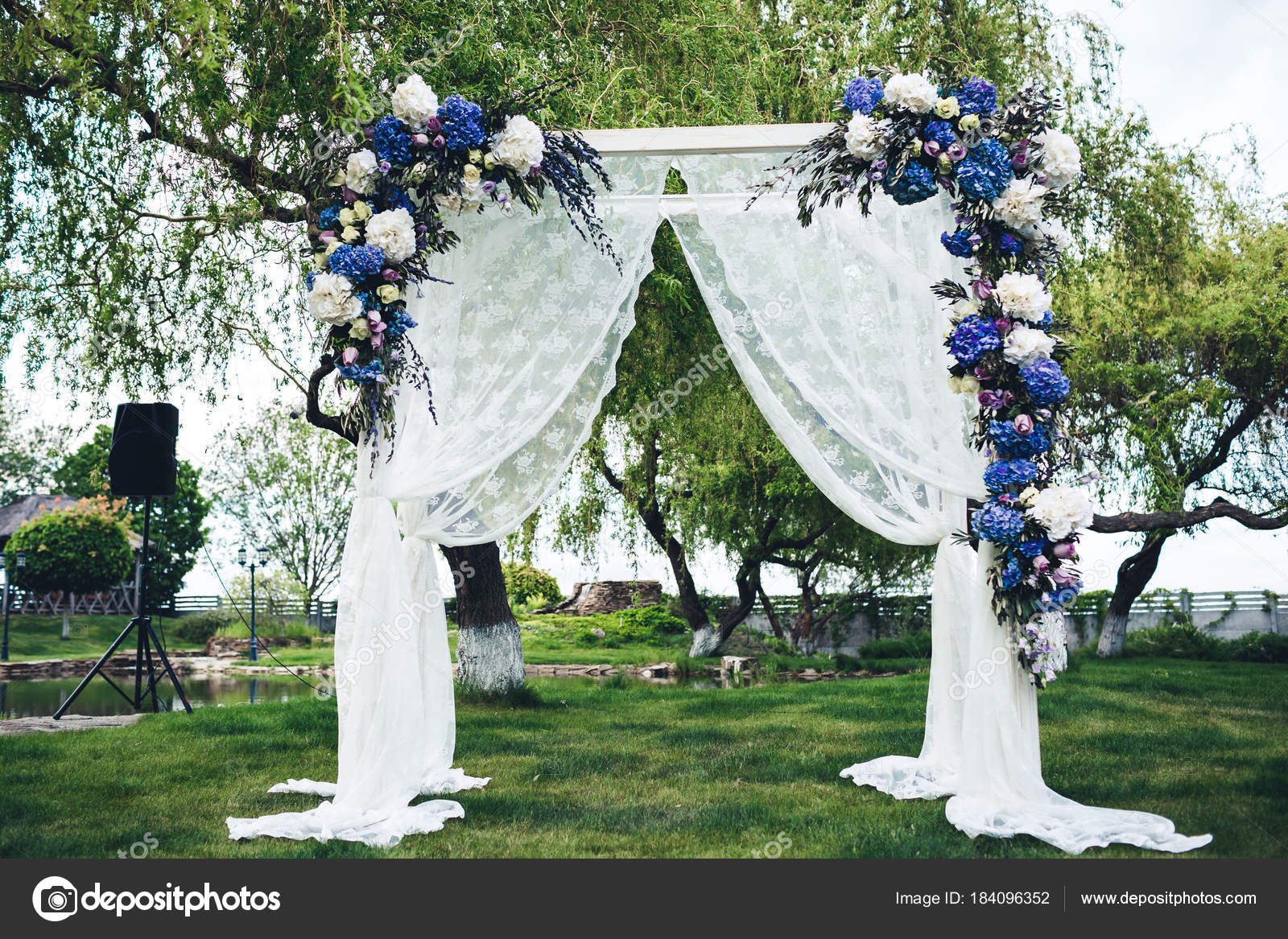 Wedding arch decorated with fabric and flowers stock photo wedding arch decorated with fabric and flowers stock photo junglespirit Image collections