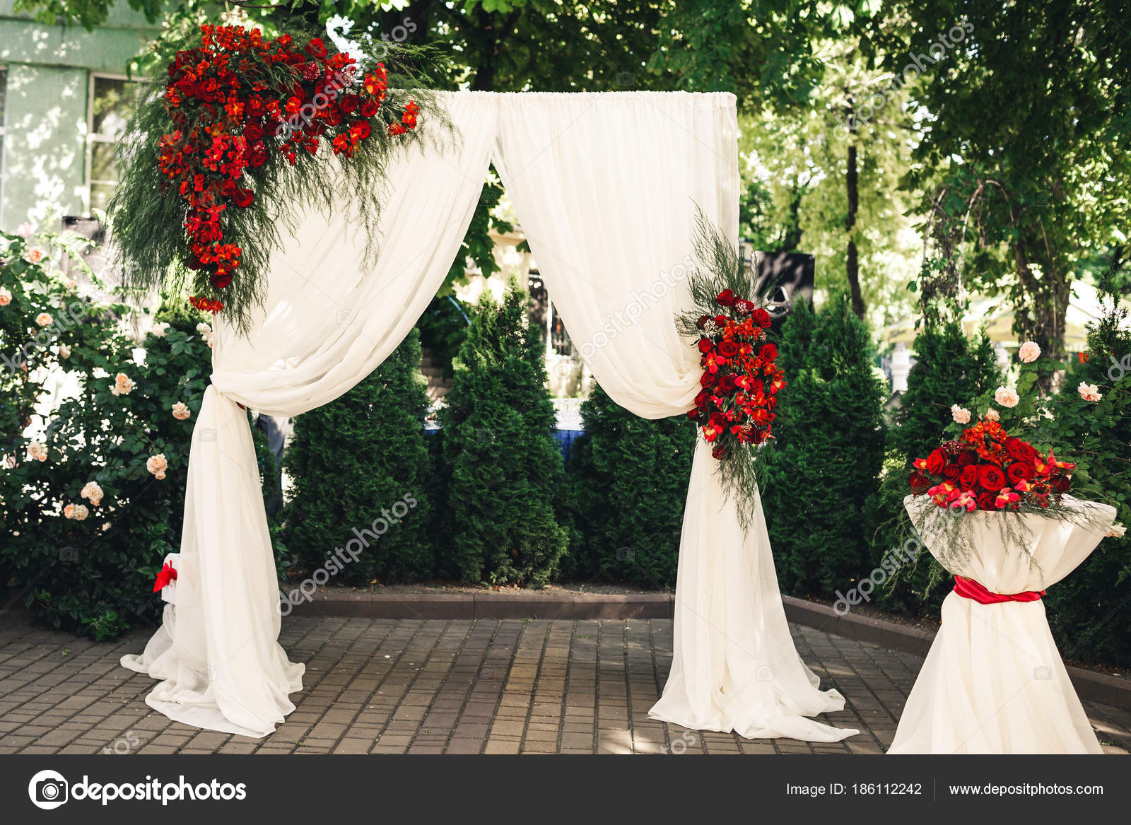 Wedding arch and table decorated with flowers stock photo wedding arch and table decorated with flowers wedding decorations photo by varnavaphoto junglespirit Choice Image