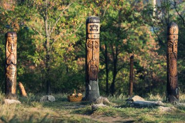Wooden sculptures of pagan gods on island Khortitsa in city Zaporozhye, Ukraine